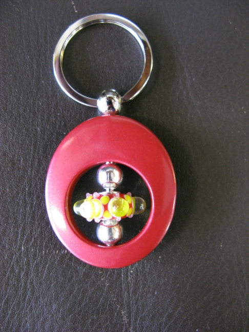 Red Oval Keyring - Red-Yellow Dot